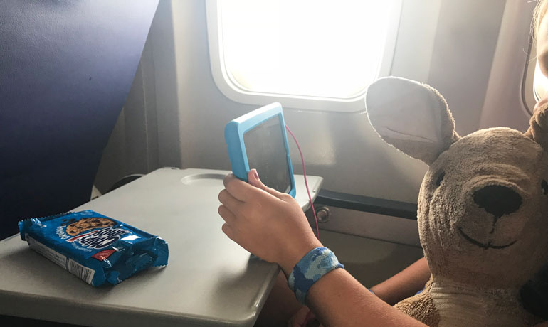 flying with kids take a tablet