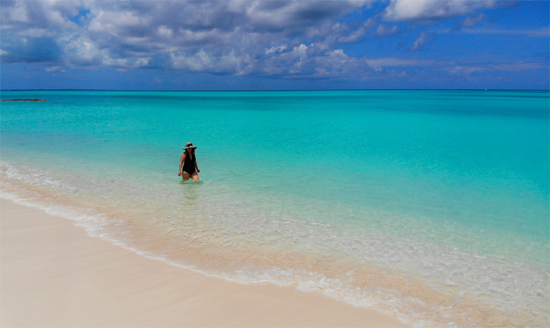 best beaches in turks and caicos islands - Nikki walking in the water at Leeward beach