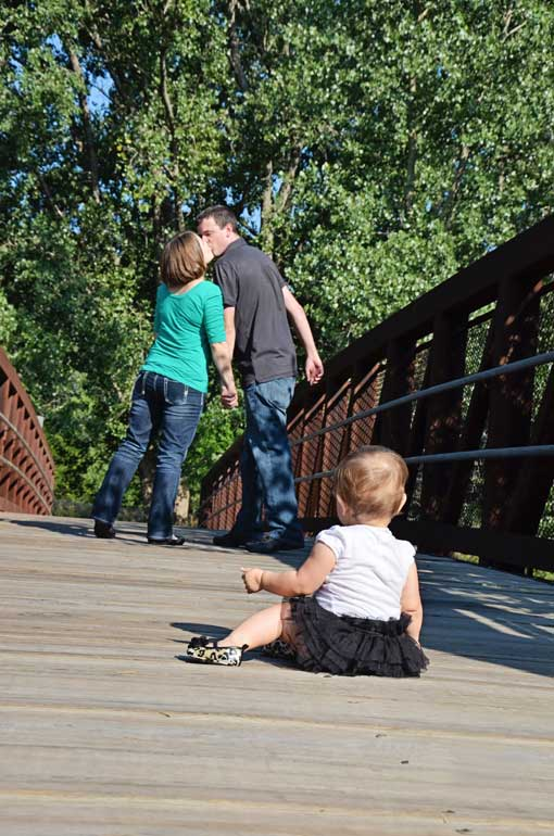 family photos on a bridge in Omaha NE