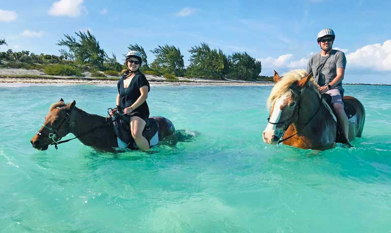 Travel couple horseback riding turks and caicos