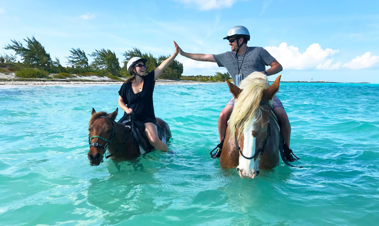 horseback riding turks and caicos high five on horseback in turquoise waters