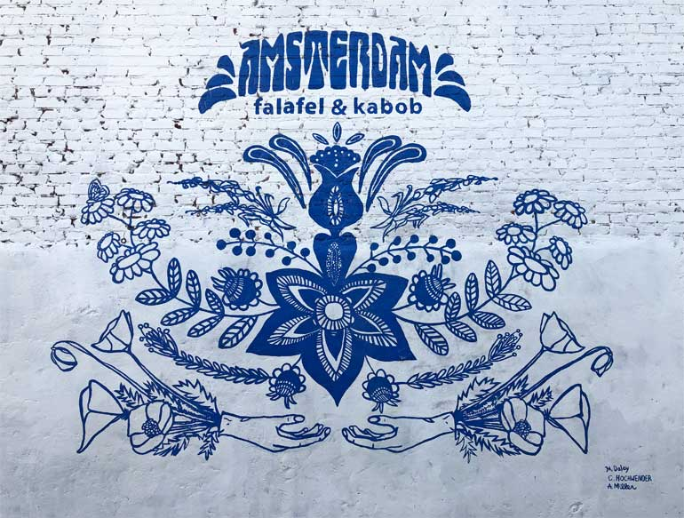 mural in Omaha at Amsterdam falafel and kabob blue and white with flowers
