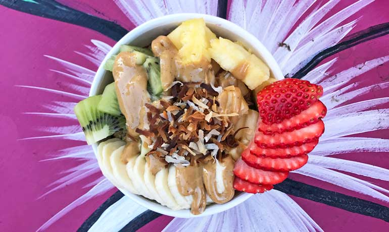 maui acai bowl with fruit, peanut butter and coconut