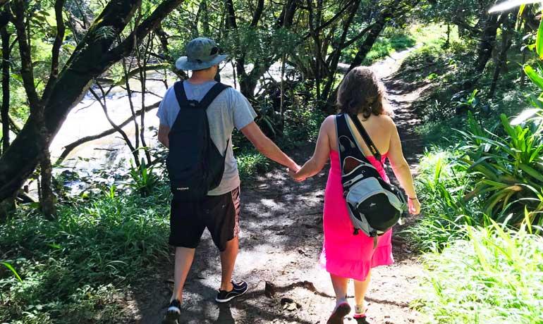 couple hiking in Maui twin falls