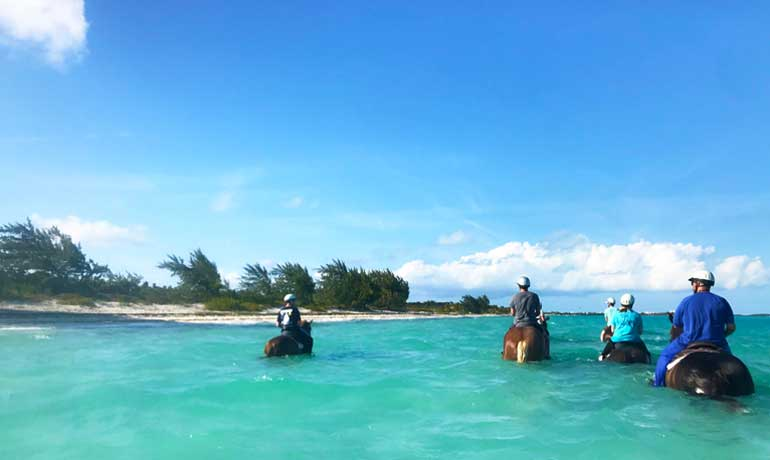 horseback riding on the beach group tour riding in the turquoise caribbean water
