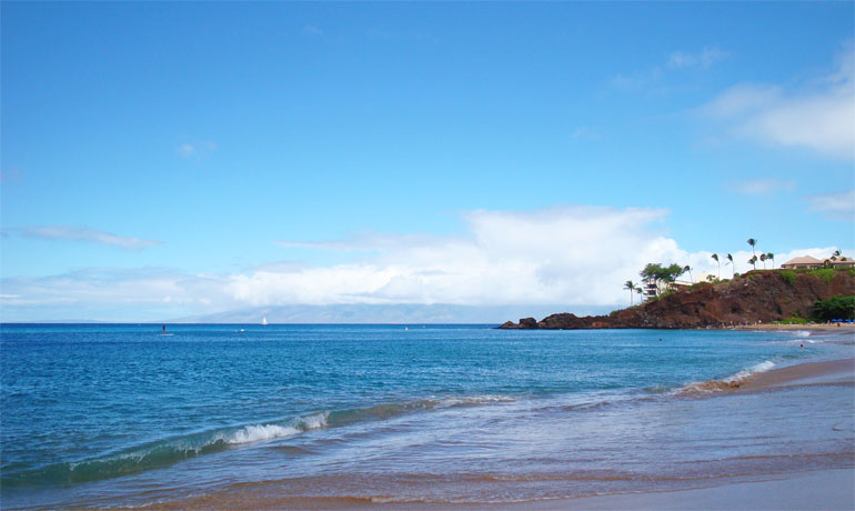 Kaanapali beach overlooking black rock with blue sky