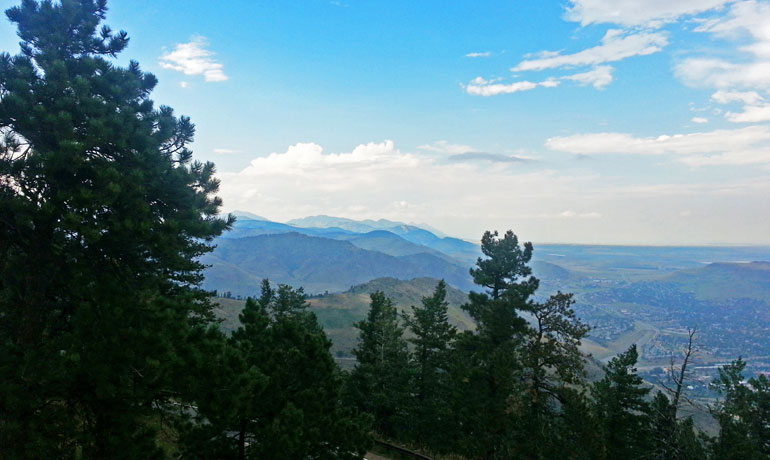 trip or vacation overlooking the rocky mountains with a town in the valley