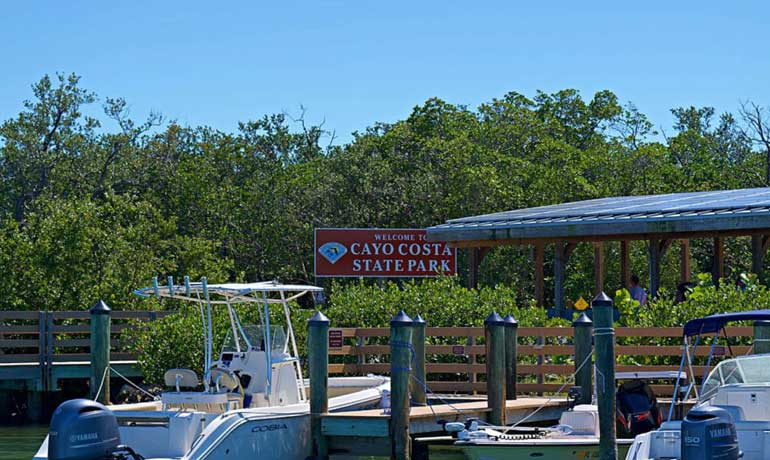 cayo costa state park sign and boats docking