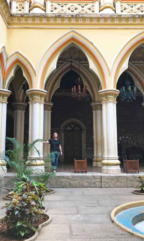 standing in a doorway of the Bangalore Palace