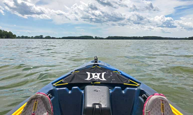 kayaking on a lake near estherville front of kayak on lake
