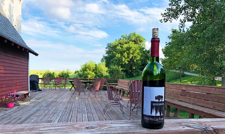 little swan lake winery bottle and outdoor deck
