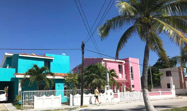 beach town in Mexico Puerto Morelos pink and blue house