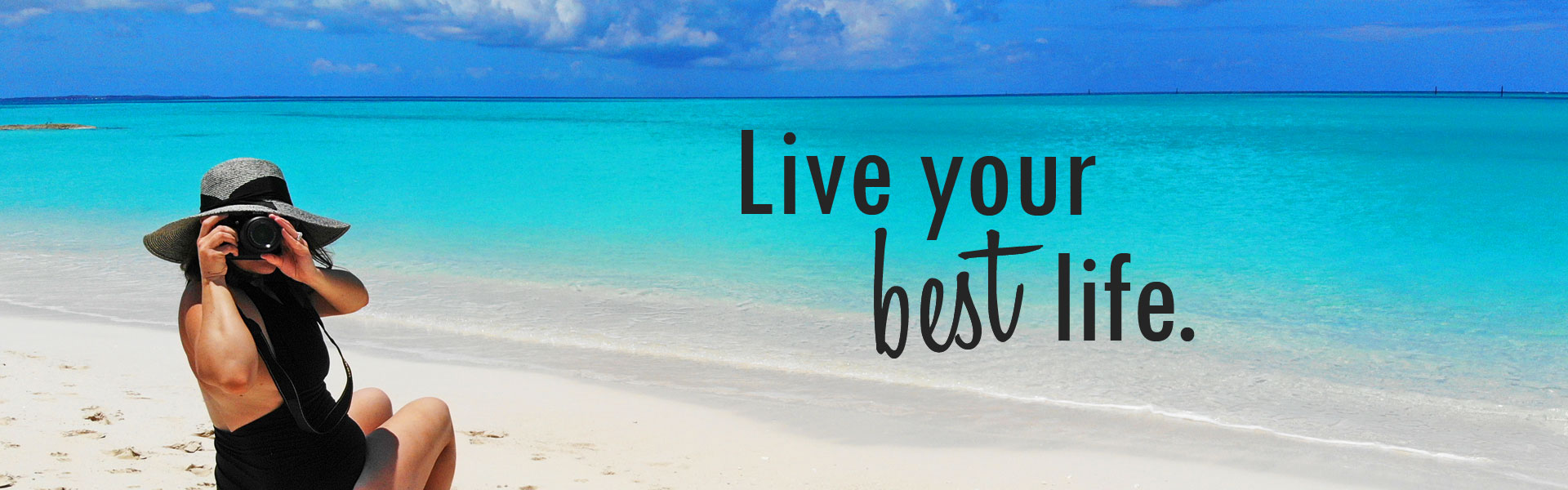 Live your best life - Nikki on perfect white sand beach with camera