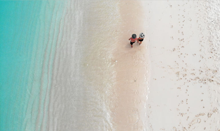 white sand of turks and caicos walking on beach