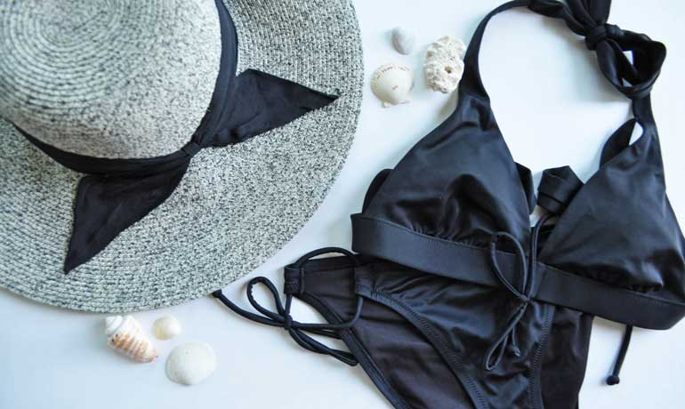 pack a swimming suit and beach hat for your vacation