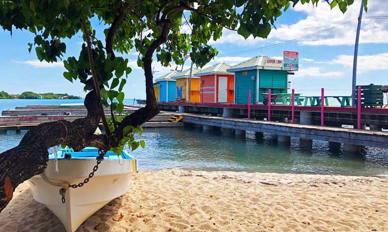 Picturesque and budget-friendly beach, boat and pier in Belize