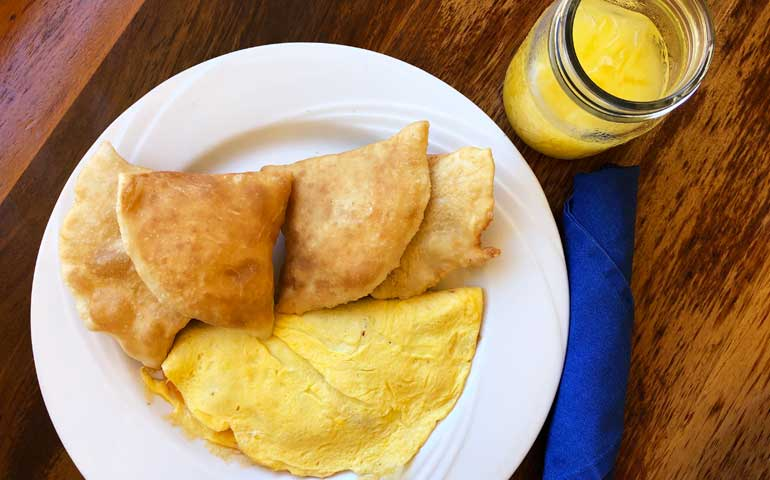 Belize food - fry jacks and omlette in Placencia