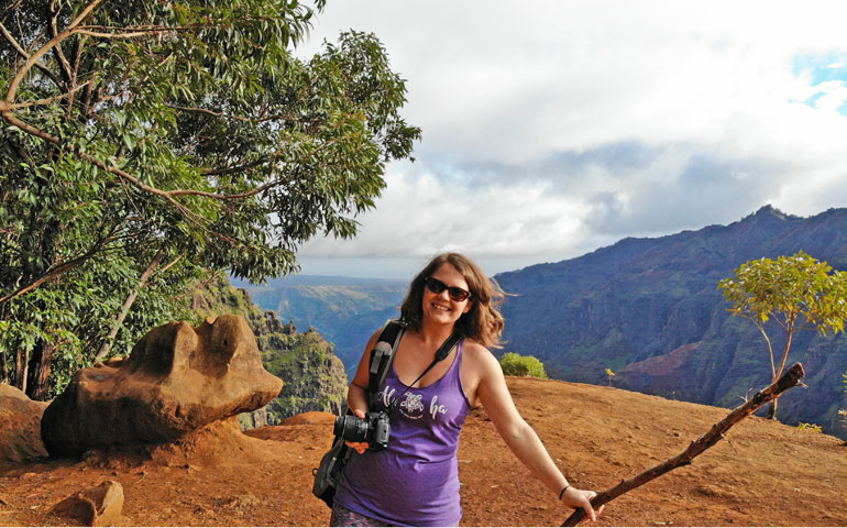 Hiking Waimea Canyon with canyon in background