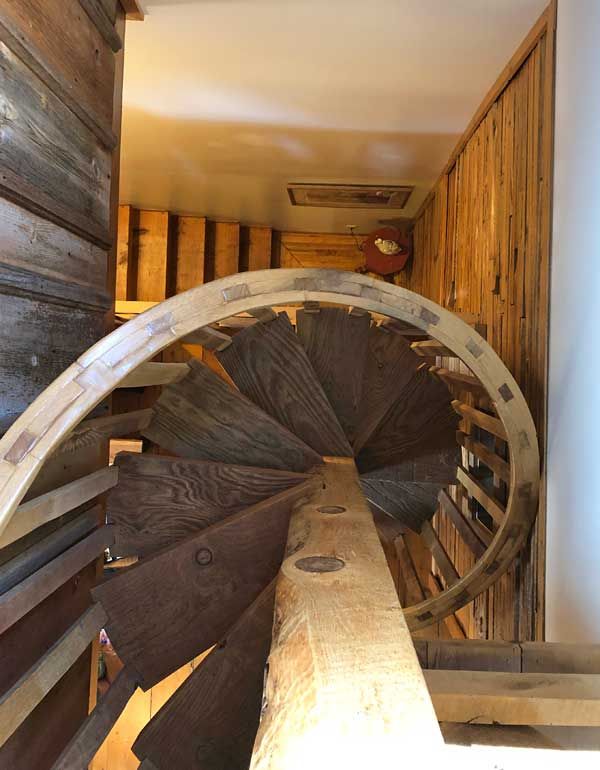 this B&B has a circular stairway going up to the top deck