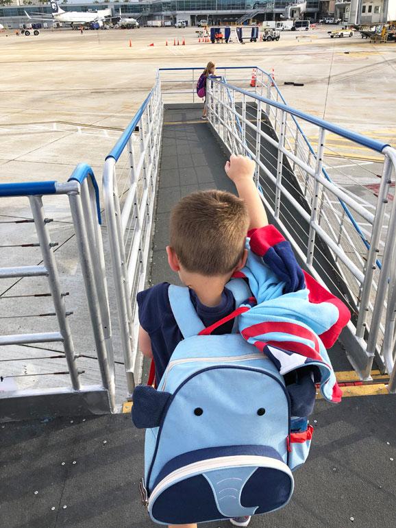 celebrating kids first flight on tarmac