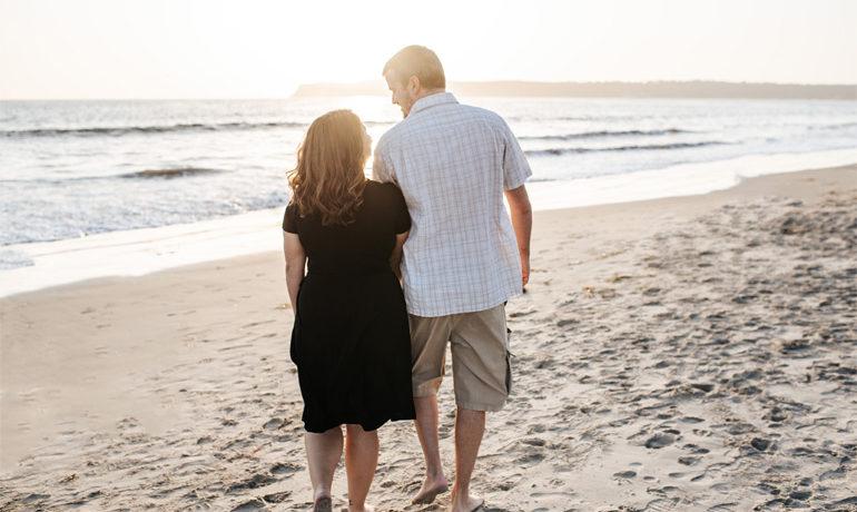 couple on beach who master finances