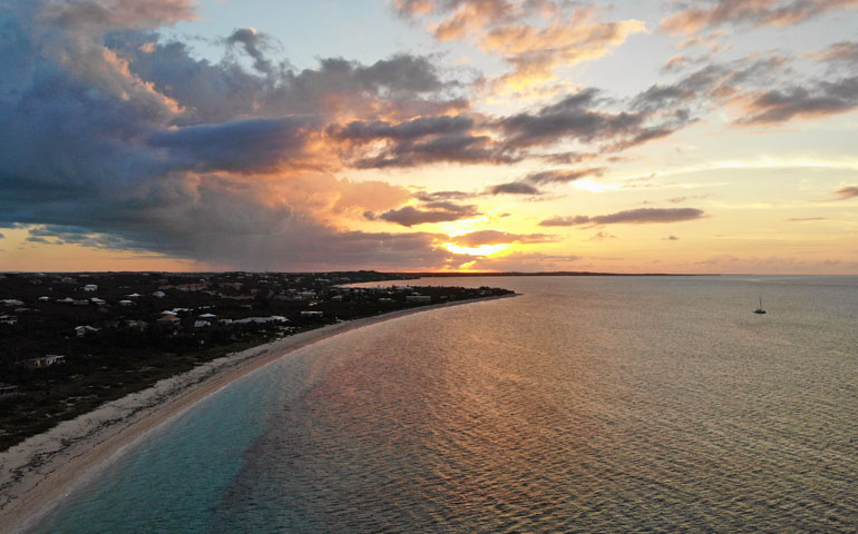 sunset over Bight Beach Turks and Caicos in the distance