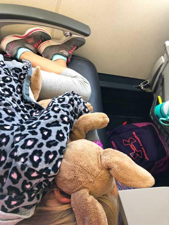 sleeping kid on airlplane