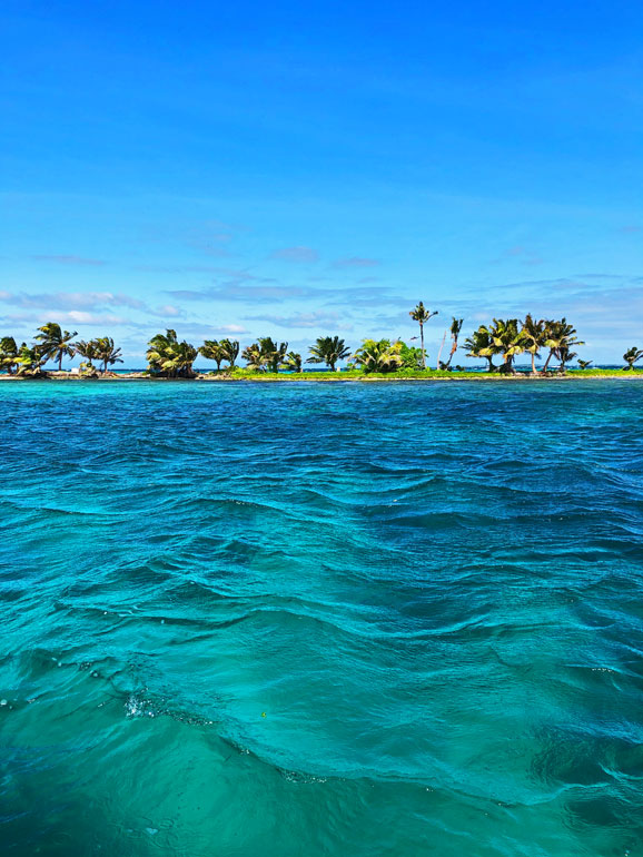 turquoise waters of Belize with island in background