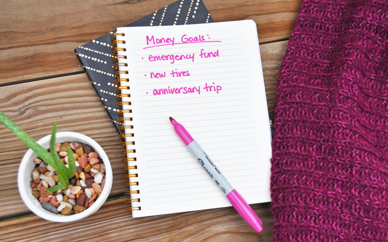money goals emergency fund during coronavirus on notebook