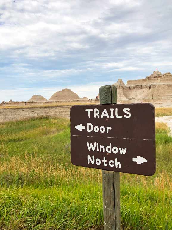 badlands hiking sign the door and window notch