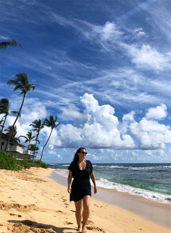 walking the beach in kauai hawaii