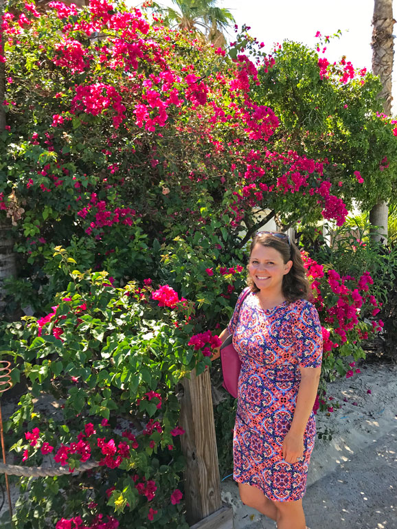 turks and caicos sights standing in front of a flower wall