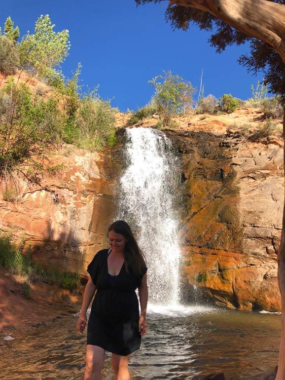 Faux Falls Utah woman standing at waterfall