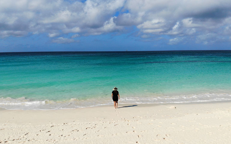 walking on divi beach Aruba